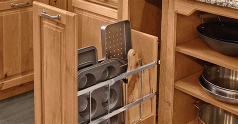 Vertical Kitchen Cabinet Dividers Vertical Dividers Pull Outs And Roll Out Trays Are Three Simple Solutions For Organizing Baking