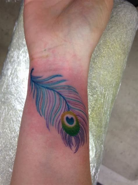 peacock feather tattoos 57 attractive wrist feather tattoos