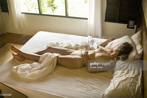 naked girl in bed naked woman lying in bed stock photo getty images