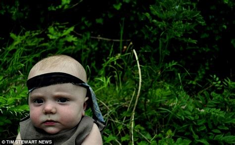 this looks exactly like rambo when we cut his hair and i m in the movies baby the six month old boy dressed up