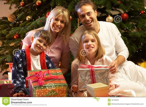 family christmas tree jarrettsville and child opening gift royalty free stock photo cartoondealer 35315931