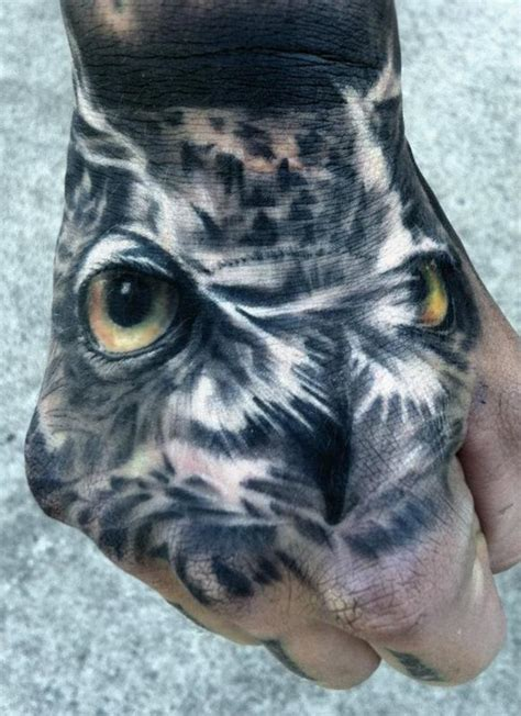 owl hand tattoo realistic owl by dean lawton tattoonow