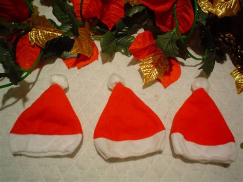 six doll size santa hats