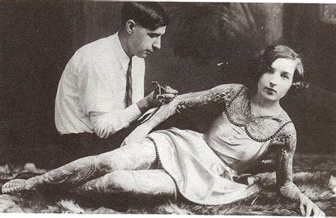 female tattoo history a woman being tattooed early 1900s vintage everyday