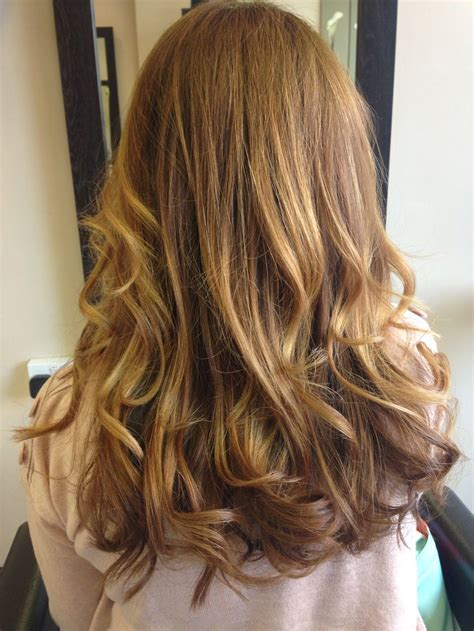 ambre hair on a nlone soft ambre with brown roots copper and blonde highlights