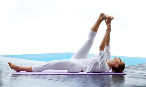 reclining big toe pose 9 yoga moves to help with pms the beachbody blog