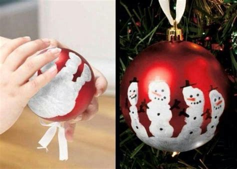 printing a handprint onto christmas baubles makes cute
