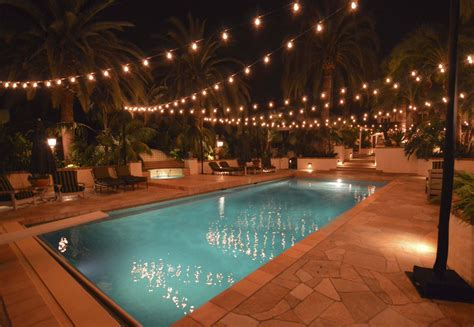 backyard hanging lights hanging patio string lights a pattern of perfection yard envy