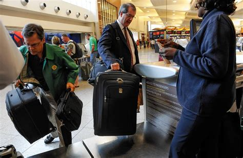 baggage laid out at airline luggage counter after flight u s open qualifying contestant withdraws after american