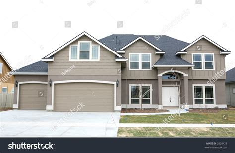 creating a home in this two story house adorable home brown two story house three car stock photo 2828428