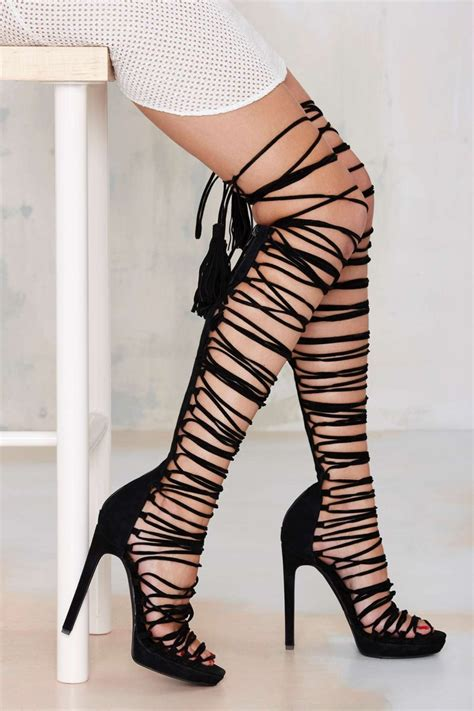 thigh high lace up sandals get the look rihanna s thigh high lace up sandals1966