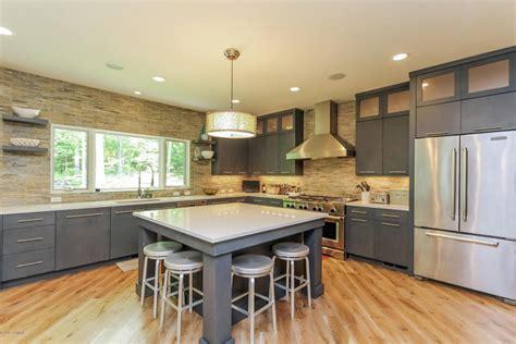Amazing Kitchen Cabinets That Sit On Countertop #2: Grey-kitchen-island-with-white-quartz-counter.jpg