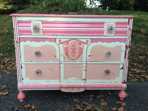 shabby chic pink and white dresser with glass knobs