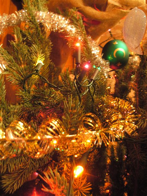 christmas decor images file christmas decorations on a tree closeup jpg