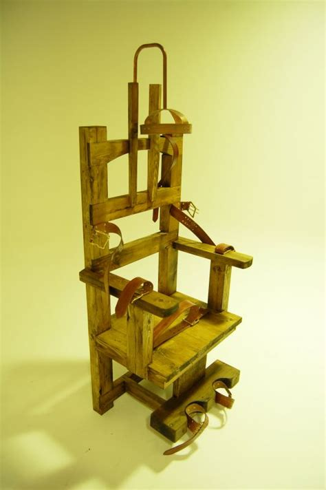 wooden electric chair  leather restraining straps