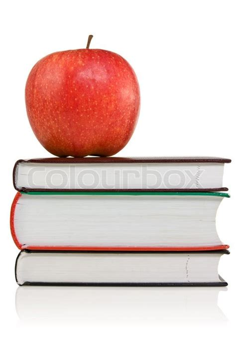 apple picture book stack of books with a apple on the top stock photo