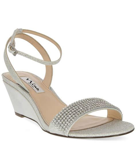 noely mid wedge evening sandals in silver lyst