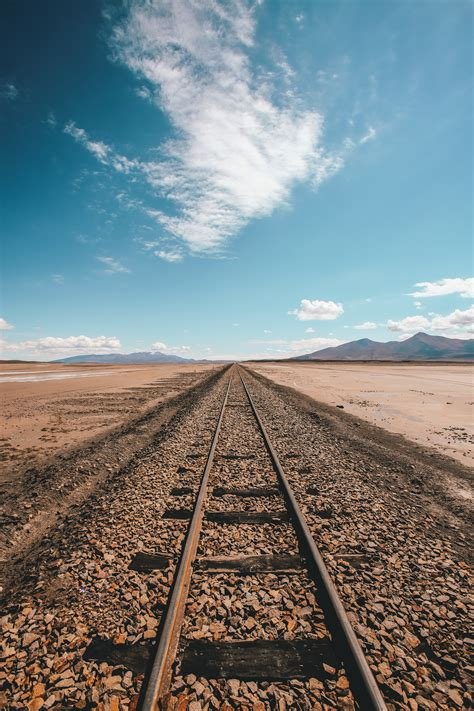 brown train track railway skyline sky hd wallpaper