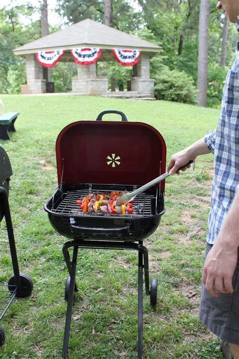 this portable charcoal grill is on wheels so it s easy to