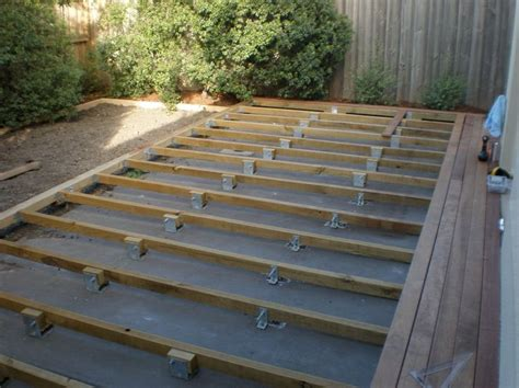 attaching a low deck to a concrete slab patio backyard