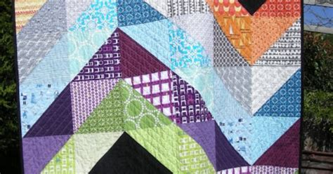 black and white hst quilt pattern large half square triangles hst on black background
