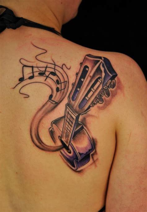 finger tattoo guitar 35 awesome music tattoos desiznworld