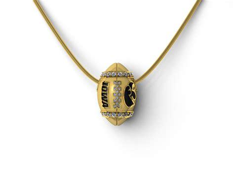 Hawkeye Pearly Gold hawkeye yellow gold and football pendant