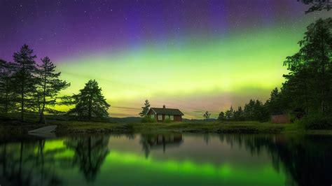 norway northern lights reflected   lake windows  hd