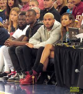 Rihanna watches chris brown play basketball in courtside seats photo