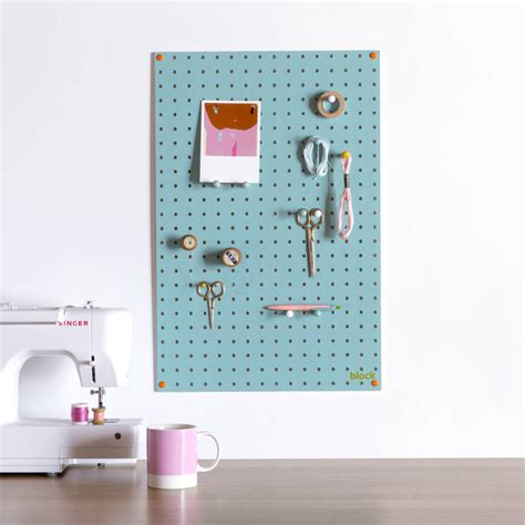 white pegboard with wooden pegs small by block design blue pegboard with wooden pegs medium by block