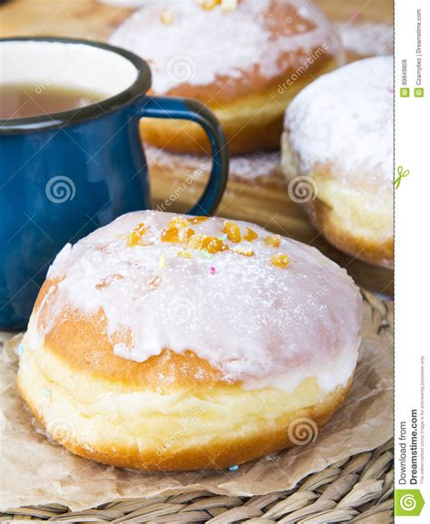the cultivation and manufacture of tea classic reprint books classic glazed donuts and mug of tea stock photo image