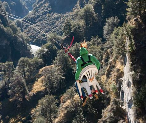 swing new zealand ride the chair of on world s highest cliff drop