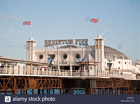 the palace pier and theatre brighton later brighton pier palace pier with union jack flags and sign brighton pier