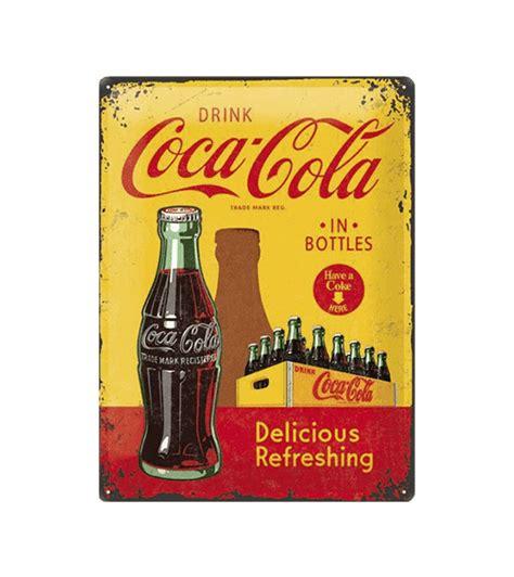 10 refreshing coca cola tattoos tattoodo coca cola delicious refreshing 1930 metalen bord