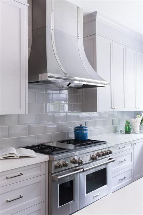 shaker cabinets with beveled edge subway tile backsplash white quartz and cabinets on pinterest