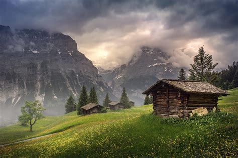 cottage in the mountains wallpaper grindelwald bern canton switzerland valley mist clouds grass cottage mountains