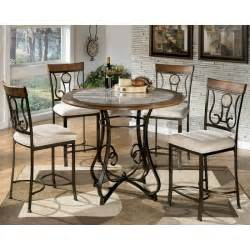 Ashley Furniture Dining Room Tables Hopstand Round Dining Table And 4 Uph Side Chairs D314