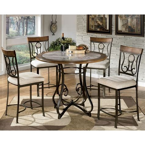 dining room side table ashley furniture dining room table hopstand round dining table and 4 uph side chairs d314