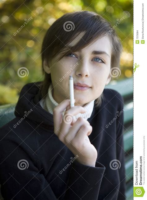 very young little girls smoking closeup portrait of the smoking young girl stock images