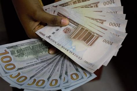 currency converter dollar to naira naira strengthens to n450 1 as cbn pumps in more dollars