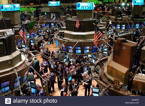 Stock Market Floor by Stockbrokers Busy On The Trading Floor Of The New York