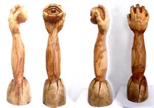 emerging eye olive wood sculpture eric kempson