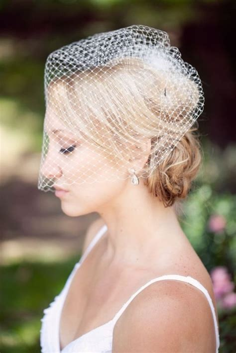 wedding updos with birdcage veil shellita s blog opting for an asymmetrical dress in black