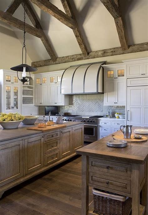 small white kitchen with steel hood white barrel kitchen hood with steel straps transitional