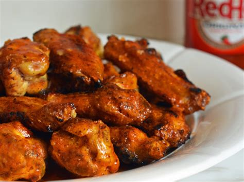 hot chicken wing marinade grilled chicken wings with seasoned buffalo sauce once