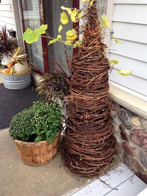 grapevine tree made with a tomato cage love it fall