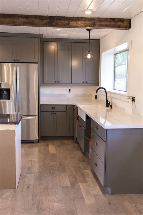 gray shaker kitchen cabinets with engineered white quartz jenna sue kitchen chronicles the counters are in