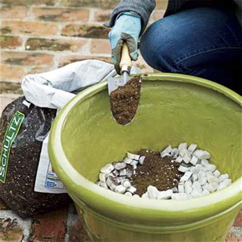 What To Put In Bottom Of Planter For Drainage 25 Totally Clever Gardening Tips Tricks