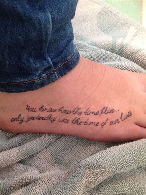 lettering right foot tattoo