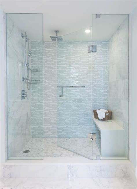 Glass Walk In Shower Doors Large Walk In Shower Features A Seamless Glass Door Framing A Large Marble